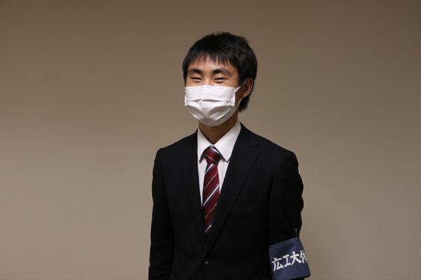 講演会の担当者を務めた近藤輝明さん(電子情報工学科)3年。