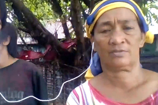 ゴミ山で40年近く暮らす女性。「プラスチックボトルとか金属とかをゴミから拾えば、お金に換えられる。ゴミ山がなくなると困ります」
